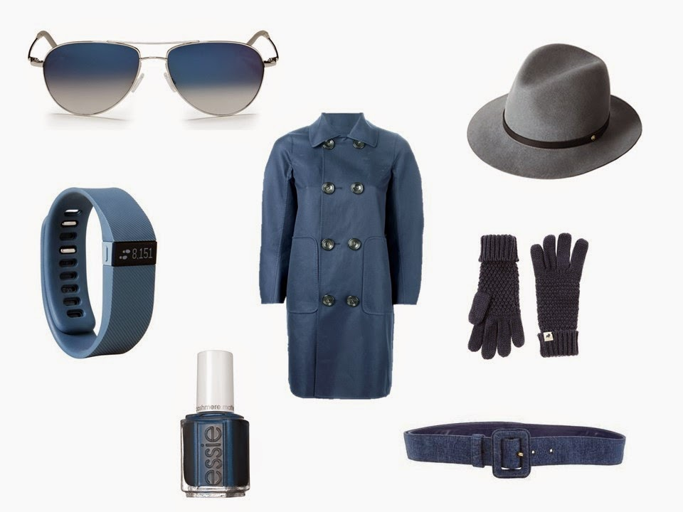 Smoky blue coat with sunglasses, Fitbit, nail polish, fedora, gloves and a belt in coordinating blue