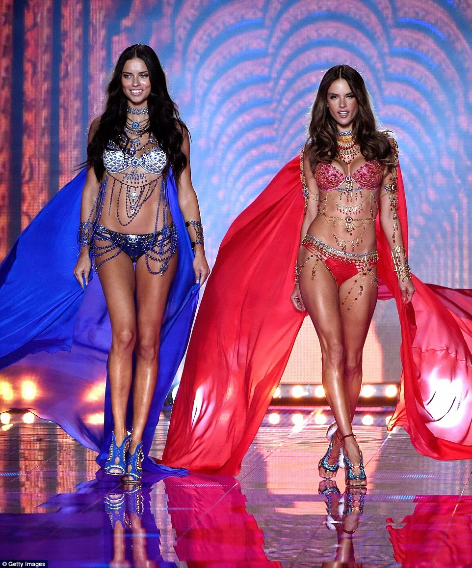 Adriana Lima and Alessandra Ambrosio wear the VS Dream Angels Fantasy Bras at the 2014 Victoria's Secret Fashion Show