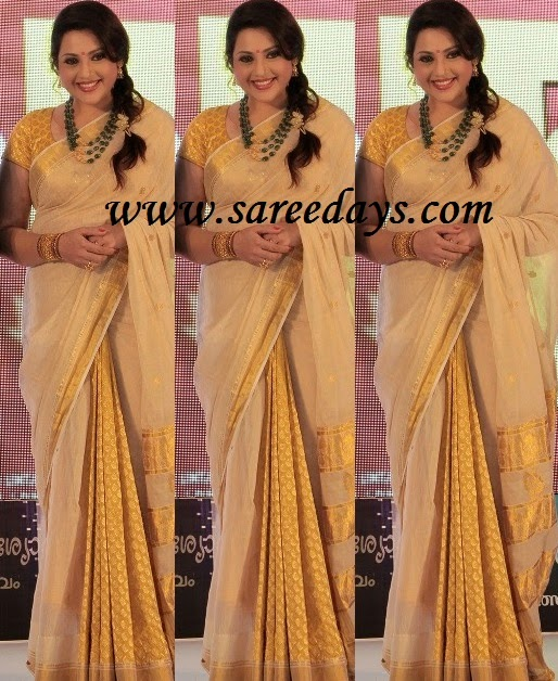 Latest saree designs march 2015 checkout meena in beige georgette saree with zari work and paired with matching short sleeves blouse altavistaventures Image collections