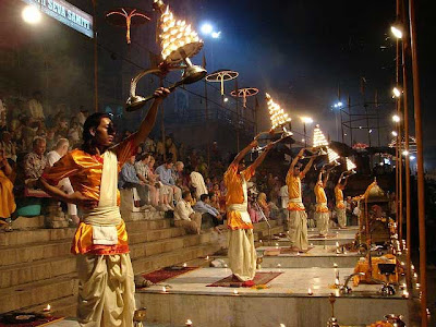Brahmins perform arati on the banks of the Ganges River in Varanasi India