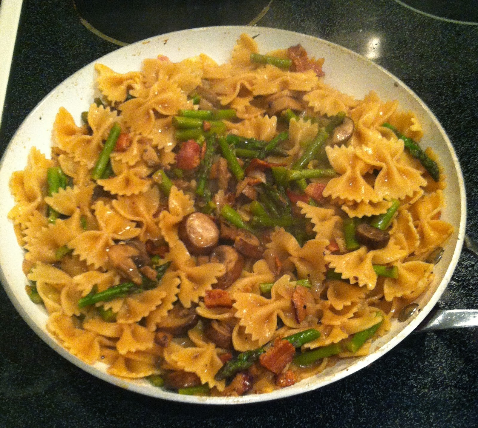 Pasta with bacon, mushrooms and asparagus in Marsala sauce