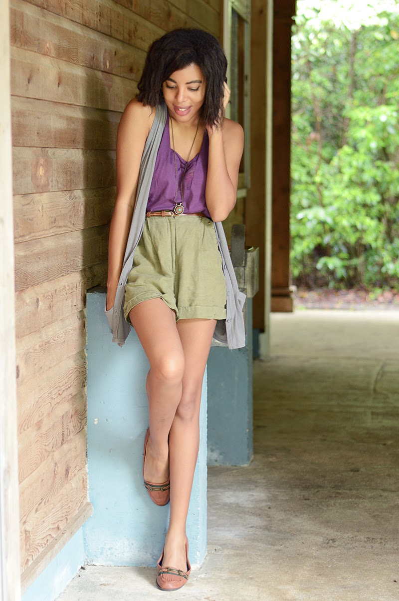 Miami Fashion Blogger Anais Alexandre of Down to Stars in an Urban Outfitter tank with vintage olive shorts and a thrifted vest with GoJane leather loafers