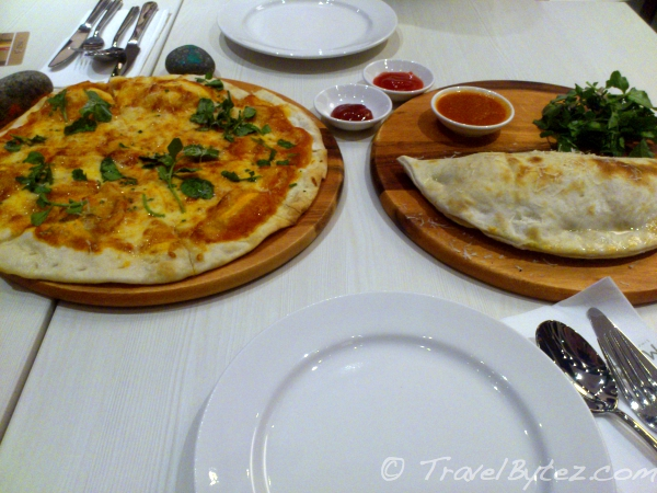 Margherita Pizza and a Pesto Chicken Calzone