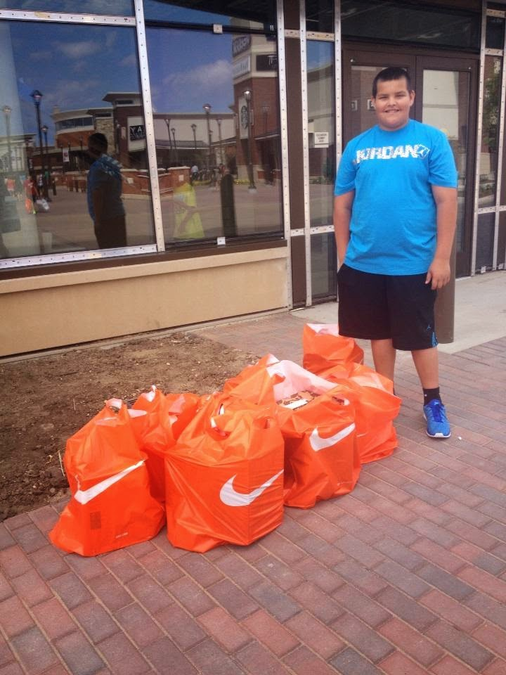 kid in eagan buys $1000 of Nike shoes at new outlet mall