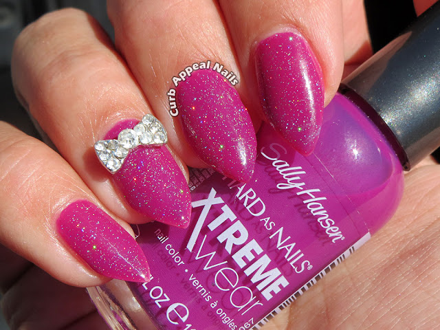 Sparkly Purple Nails with Cute Bow Charm
