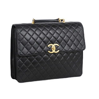 "Vintage 1990's black leather quilted Chanel computer bag with gold ""CC"" logo."