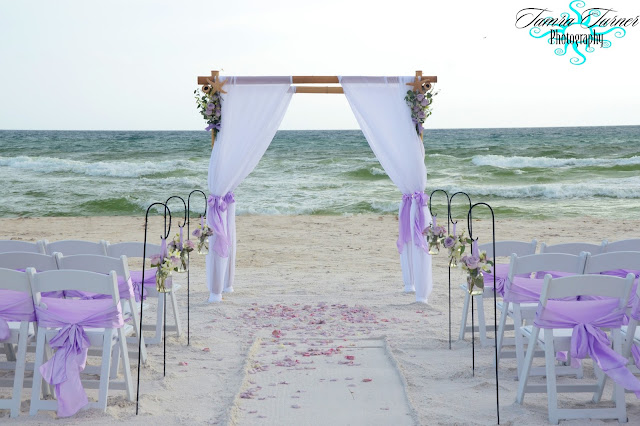 Beach wedding arbor with fresh flower bouquets in Panama City Beach