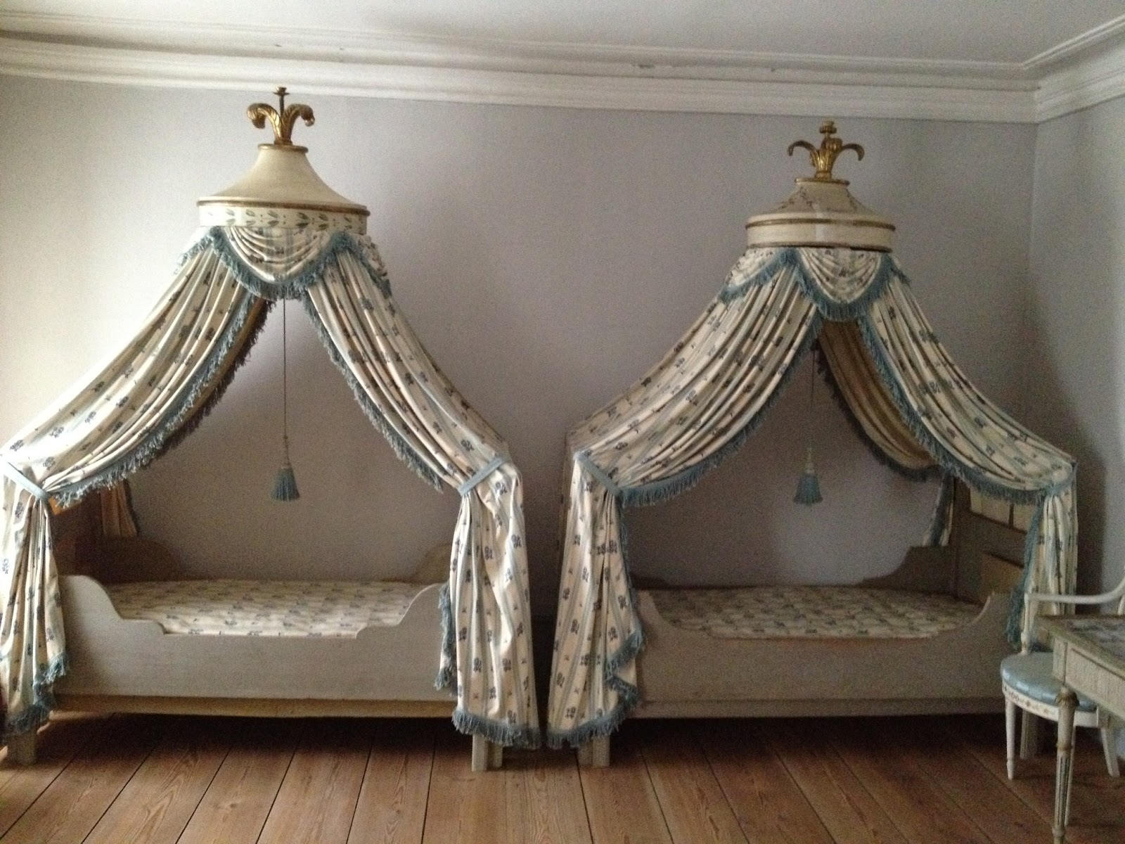 images crop drape corbis abode getty coronet to how documentary a crown canopy bed drapes make