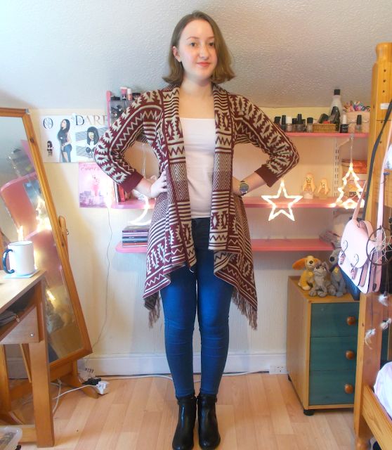 An autumnal outfit including an aztec printed blanket jacket, black ankle boots from New Look & a watch from Weird Ape!
