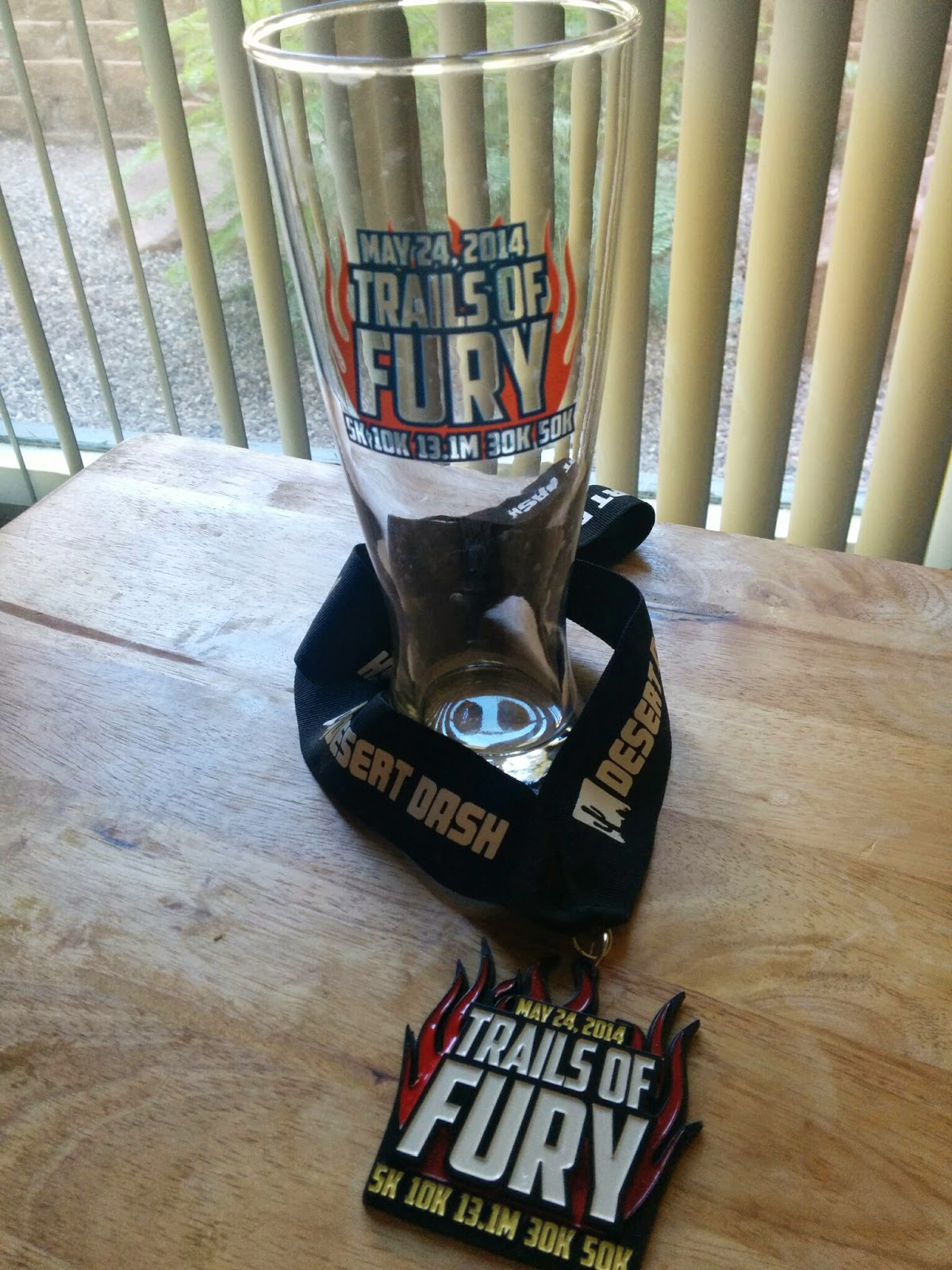 Trails of Fury 2014 race medal and pilsner