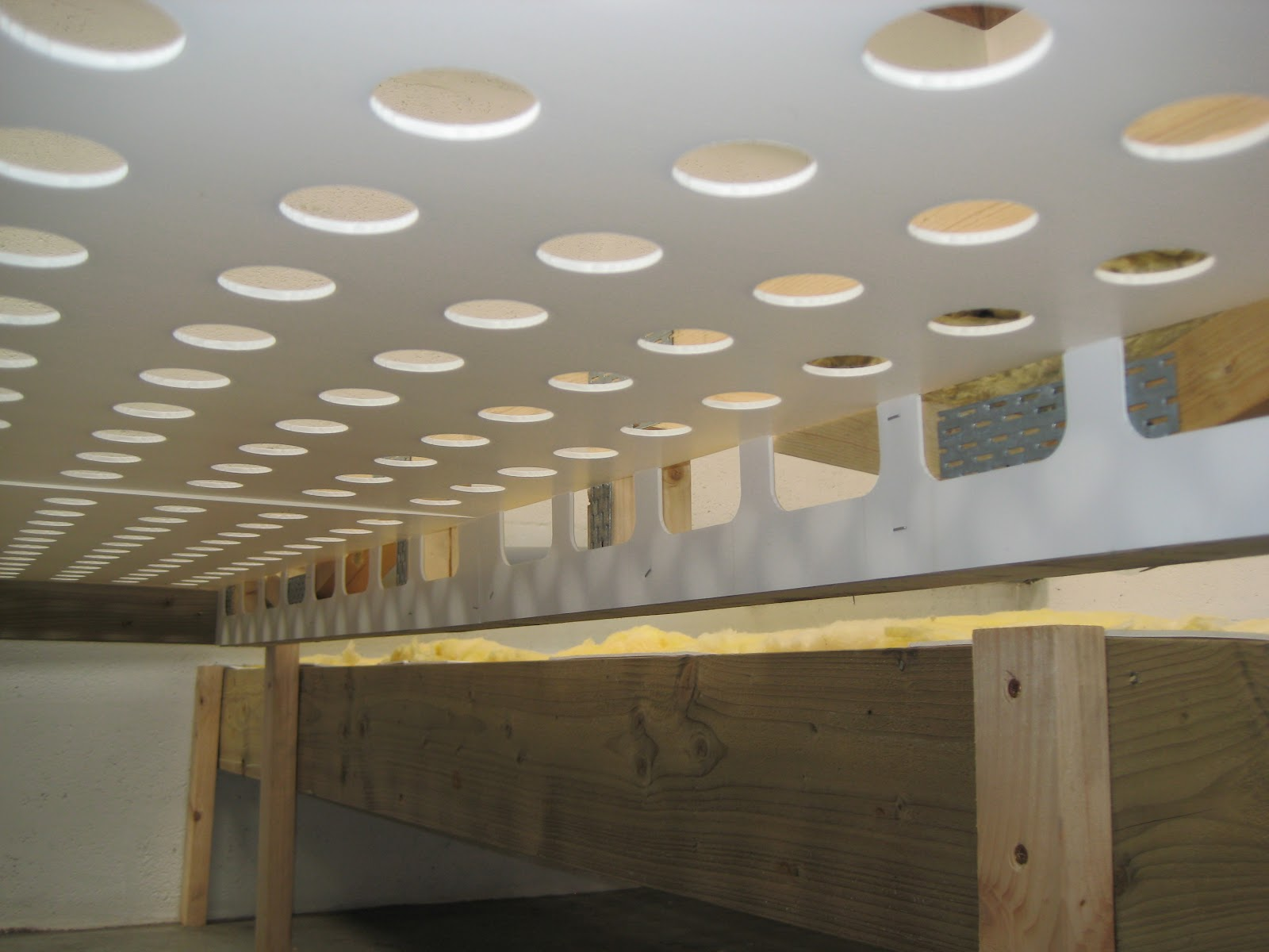 Steel open web joist construction insumate underfloor for Floor joist insulation