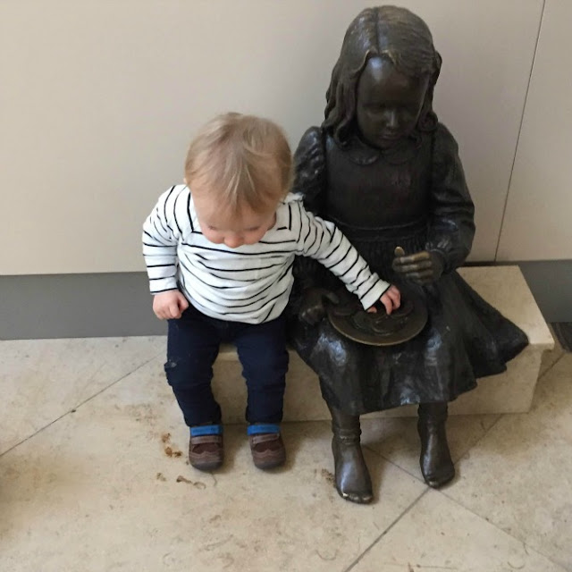 Squidge playing with a bronze little girl