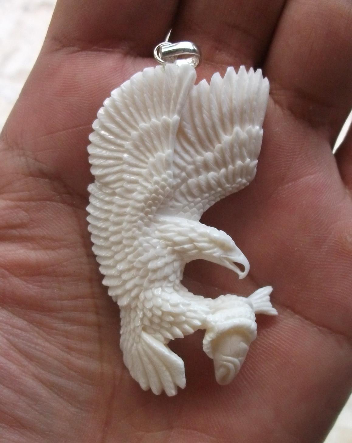 Eagle carved bone pendants carving