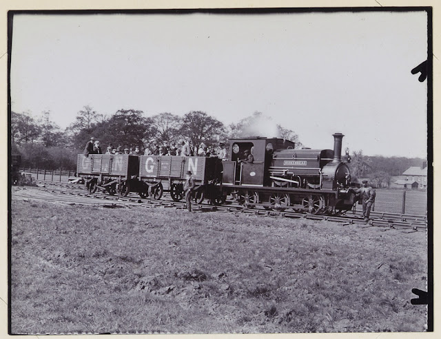 Our Special. Geologists' Association excursion to Hertford & Stevenage, May 2nd 1914. Steam engine with two open carriages full with GA members