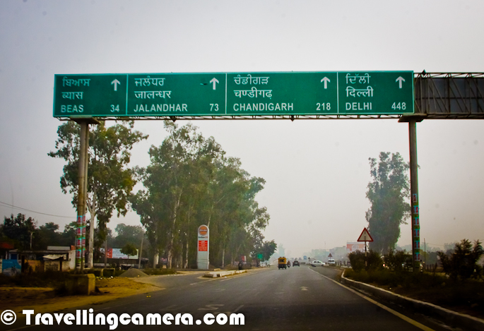 It was 31st evening of December 2011, when we thought of visiting Amritsar from Chandigarh. Idea was to celebrate New Year on the way and move towards Amritsar on early morning of 1st Jan 2012. This Photo Journey described this road journey from Phagwara to Amritsar on 1st Jan 2012...There are lot of educational institutions between Phagwara and Jalandhar. And I am sure that you must have heard of Lovely University Jalandhar :) ... One of the campus is very near to Phagwara, Punjab ! Apart from universities, colleges and huge school campuses there were lot of Marriage halls on this highway. One of the photograph in this PHOTO JOURNEY will also show you the cars used in Punjab for marriages.There are some cantonment areas on this highway. Here is one of the photograph of CRPF Gate near Amritsar. Around this region, lot of javans were cleaning the space around National Highway 1 which connects Delhi with Amritsar City of Punjab.Folks working in farms of Sugar Cane in Punjab. Check out following link to know more about Sugar Cane - http://en.wikipedia.org/wiki/SugarcanSugar Cane is one of the main crop of Punjab and there is a huge demand of Sugar Cane for sugar production. Apart from Punjab, UP has also a big Sugar industry to fulfill Sugar needs of most of the northern region of India and other parts.A Photograph of Flyover inside Amritsar City of Punjab !National Highway 1 is a National Highway in Northern India that links the National capital New Delhi to the town of Attari in Punjab near the India-Pakistan border. This was a part of Grand Trunk Road of Sher Shah Suri, that ran from Lahore to Bengal, built on earlier roads that existed from time immemorial. National highway authority of India divided it into two parts, north of Delhi, called NH 1 and south of it, called NH 2. The highway is maintained by National Highways Authority of India. This is one of the longest and oldest highways of India. Check out following link to know more about NH-1 (National Highway 1) - http://en.wikipedia.org/wiki/National_Highway_1_%28India%29There are few sugar factories on the way to Amritsar from Chandigarh. I think the above photograph shows one of the Sugar Mill at Phagwara, Punjab, India...There were lots of Jaggery and Orange vendors on both sides on this highway. We had some juice and Naresh also though of buying some Jaggery for his home. Above Photograph shows Naresh looking at Jaggery and thinking of the quantity he may want to take home.During this halt for buying Jaggery, we also thought of exploring the small Jaggery Production Unit on side of National Highway 1. Above Photograph shows the machine which is used to extract juice from sugarcane and kept in a huge container for further processing.Another Jaggery Production Unit on the way to Amritsar, Punjab. There were lot of such small units and Jaggery is generally in good demand. There is a separate Photo Journey  on the process of making Jaggery out of Sugar Cane and can be checked at http://phototravelings.blogspot.com/2012/02/jaggery-production-unit-on-road-from.htmlThis whole stretch on National Highway, was beautiful. There were some natural caves made up of trees and green leaves hanging down... As usual there were lot of Toll Plazas on this highway as well. At times, distance between two tolls was too less and non-convincing to pay them tax.Punjabi Limousine on the way from Chandigarh to Amritsar !!! (Not sure if these were modified versions or not...A limousine (or limo) is a luxury sedan or saloon car, especially one with a lengthened wheelbase or driven by a chauffeur. The chassis of a limousine may have been extended by the manufacturer or by an independent coachbuilder. These are called 'stretch' limousines and are traditionally black or white. Limousines are usually liveried vehicles, driven by professional chauffeurs. As the most expensive form of automobile ground transportation, limousines are culturally associated with extreme wealth or power and are commonly cited as examples of conspicuous consumption. Among the less wealthy, limousines are often hired during special events (most commonly weddings and funerals). Check out following link to know about Limousine http://en.wikipedia.org/wiki/LimousinWe were confused about our feelings for fog of early morning. Naresh was completely upset as he was driving the car and I was relaxed because of scenic views from my window :) ... Although people sitting on back seat were more worried as compared to Naresh :) ... Anyways, Fog didn't last for longer period of time and rest of journey was great Literally vapors were moving up out of these green fields of Punjab, India !!This photograph is my favorite. This came out well even when it was clicked from moving car. Most of the Photographs in this Photo Journey are clicked from moving car, so excuse in case find out shakes in any of these..A Photograph of Gate of National Institute of Technology, Jalandhar. To know more about various National Institutes of technology in India, check out - http://en.wikipedia.org/wiki/National_Institutes_of_TechnoloOverall this whole Road Journey to Amritsar and back to Chandigarh was wonderful with some of the closet friends & family members. After spending some time around Golden Temple, Jallianwala Bagh and Kapda market, we started our back journey. On the same night I had to come back to Delhi as Christmas vacations had ended on 1st Jan onlySo 10 holidays, around Christmas & New Year, ended well with this Road Journey from Chandigarh to Phagwara and then Amritsar. Hope to catch up with Naresh soon...