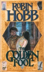 cover art for The Golden Fool, featuring two pale skinned people. One of them, presumably a young woman with long, dark hair, has her back to the audience to display colourful tattoos of dragons. The other, a man wearing a quilted coat, looks at the design.