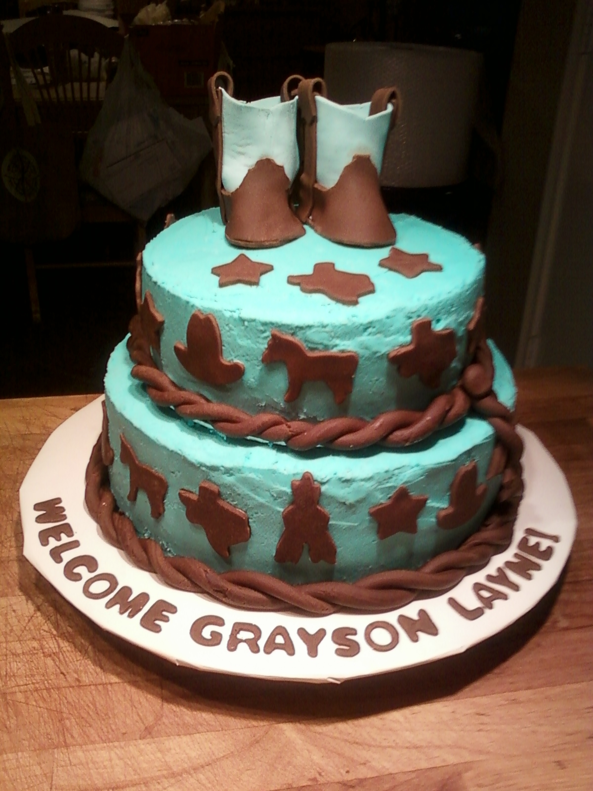 return customer requested a cowboy themed baby shower cake for her