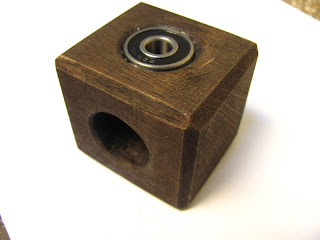 Wooden cube and skate bearing