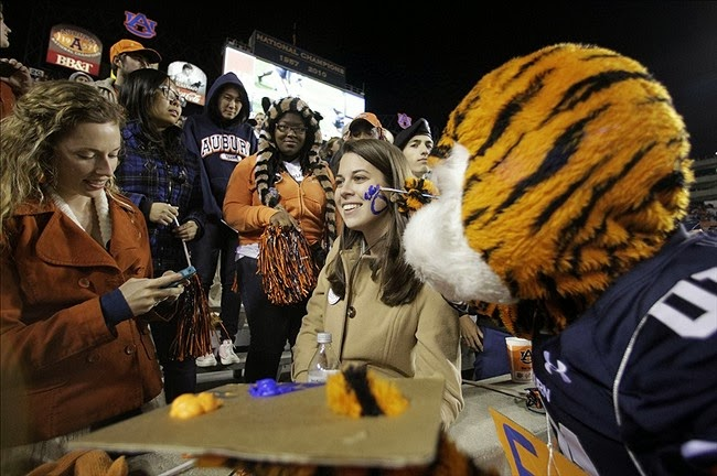Apply some orange and blue face paint in honor of the Auburn Tigers