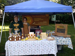Farmers Market booth selling honey