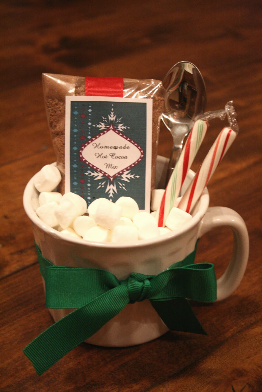 it was so fun to organize the boxes with a little hot chocolate theme plus the homemade hot cocoa mix is awesome you can make this gift for a family