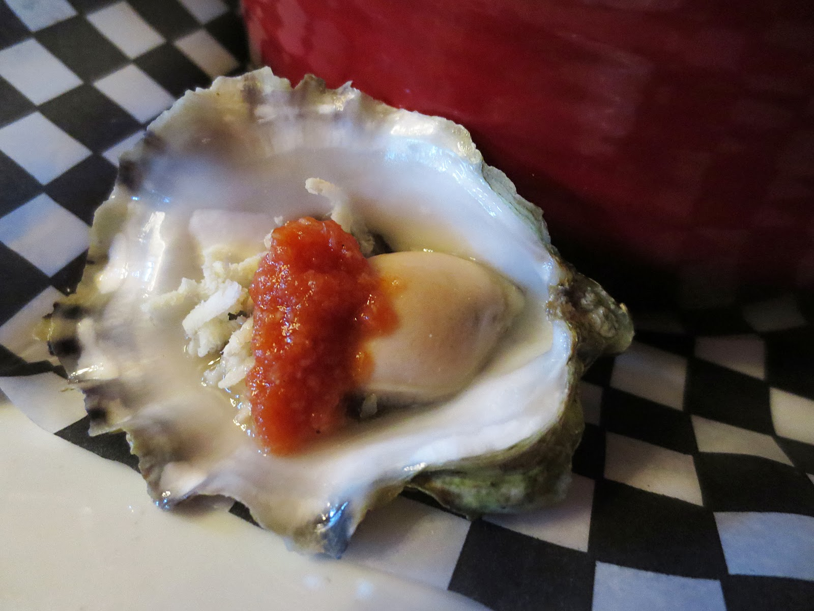 Raw oyster with spicy salsa and freshly graded horseradish