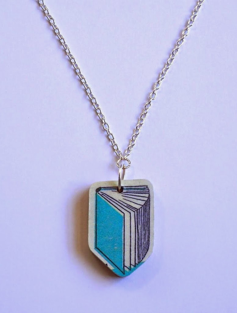 http://store.bookriot.com/collections/jewelry/products/wooden-book-necklace