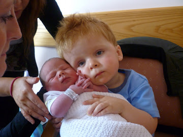 Oscar meets his baby sister Isobella!  July 2010