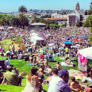 Thousands of people filling Mission Dolores Park