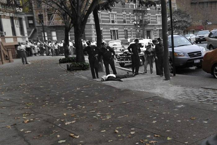 July 30, 1950. Police officers guard the body detective Michael Dower, who committed suicide.