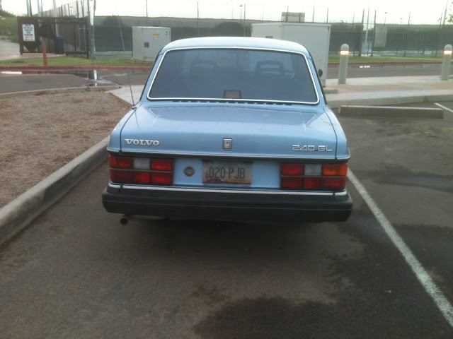 Rear view of blue 1986-1992 Volvo 240 GL in parking lot