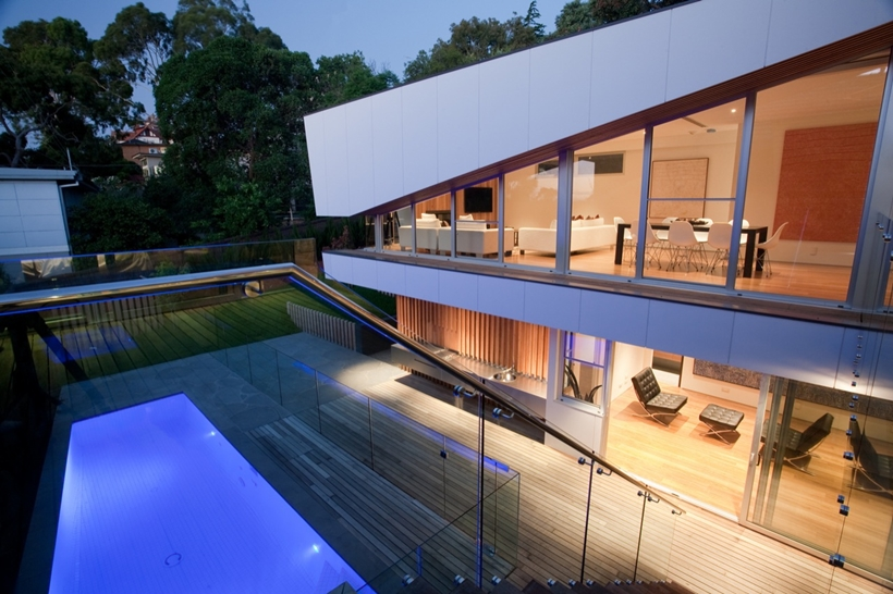 Swimming pool in the backyard of Kew House by Vibe Design Group