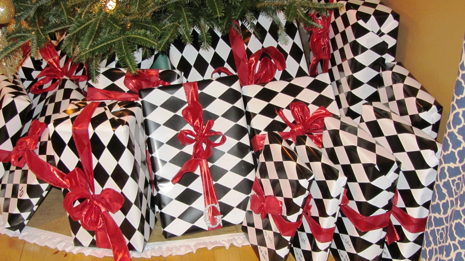 i also decided to do away with the traditional stick on gift tags each gift has the initial of the recipient since the black and white wrapping paper is - Hobby Lobby Christmas Wrapping Paper