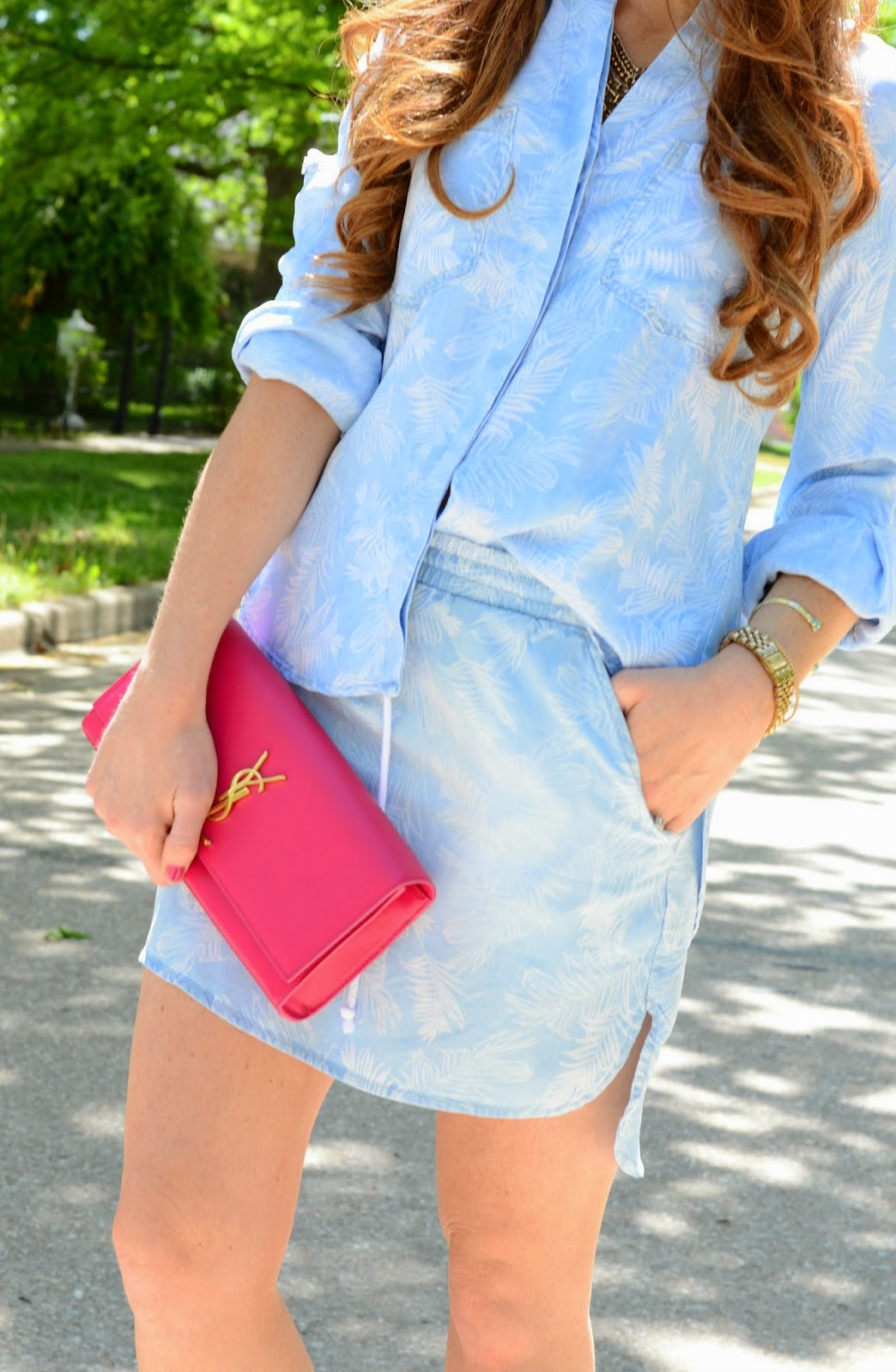 pink ysl clutch and chambray top