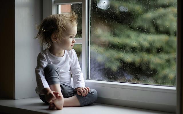 Baby Girl Looking Rain Drop