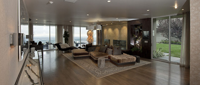 Picture of large modern living room with brown colors