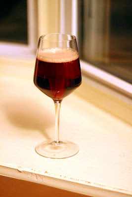 A glass of Blackberry-Mulberry sour beer.