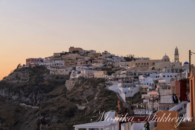Santorini Sunset Greece by Monika Mukherjee