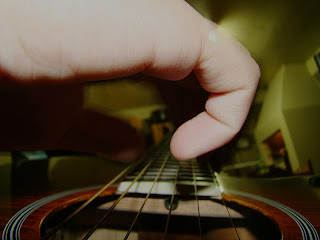 Play a Song on the Guitar