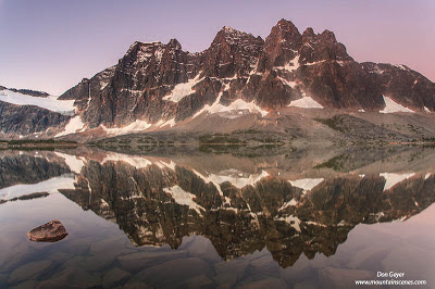 The Ramparts reflected in Amethyst Lake, Tonquin Valley, Jasper National Park, Alberta, Canada.