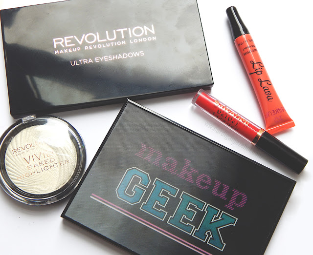 Close up of Makeup Revolution palettes, highlighter and lip products.