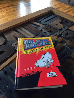 Galactic Hot Dogs: Cosmoe's Wiener Getaway is available at An Unlikely Story in Plainville, Massachusetts