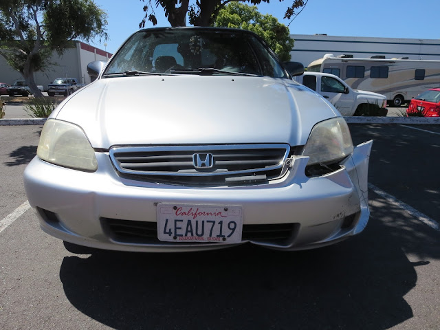 Civic with damaged bumper, grill and fender