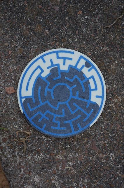 closeup of blue white and black resin cast maze coaster