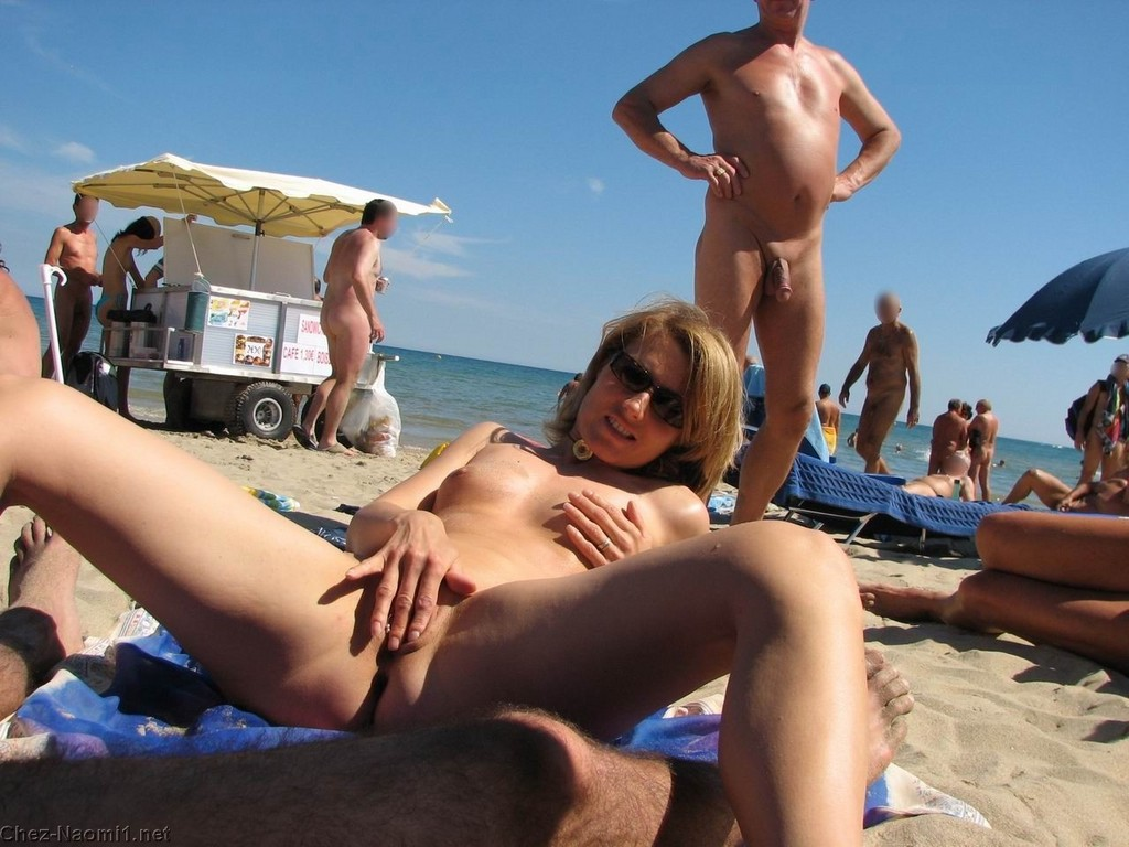 beach with nude people having sex