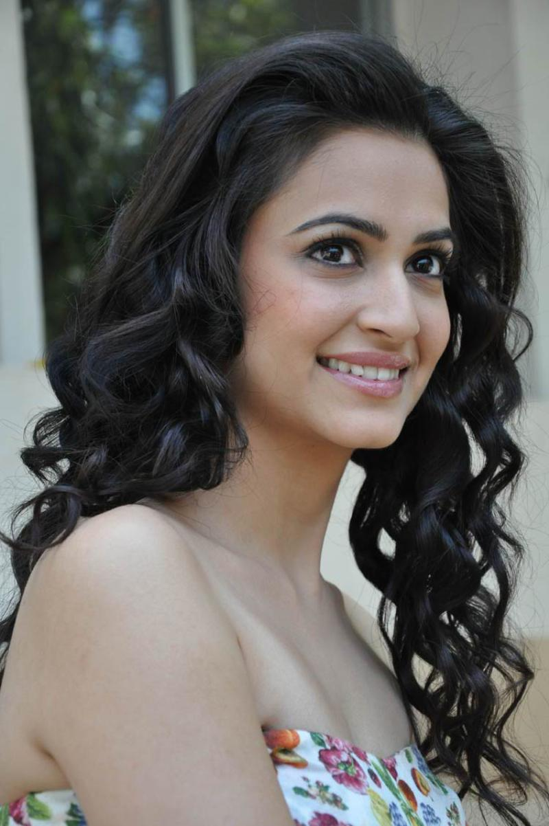 Kriti Kharbanda Cute Stills In White Dress