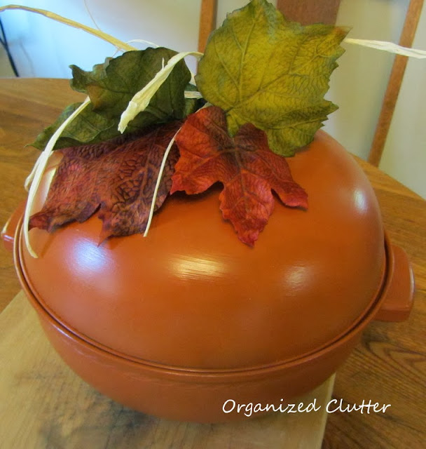 Repurposing a vintage bun warmer into a pumpkin http://organizedclutterqueen.blogspot.com/2013/10/vintage-bun-warmer-re-purposed-as.html