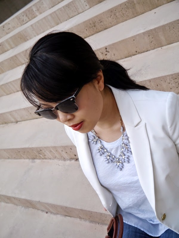 Grey and rhinstone statement necklace, low ponytail, orange lips, classic sunglasses