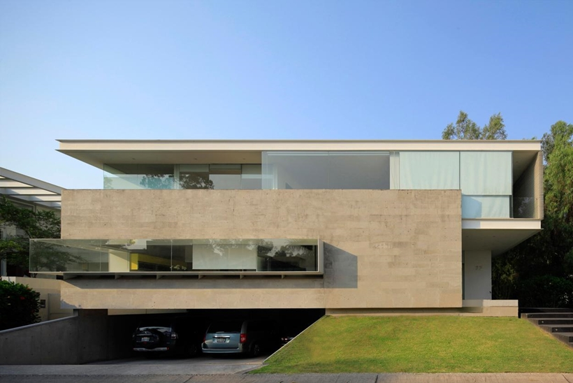 Concrete and glass facade on Godoy House by Hernandez Silva Arquitectos in Mexico