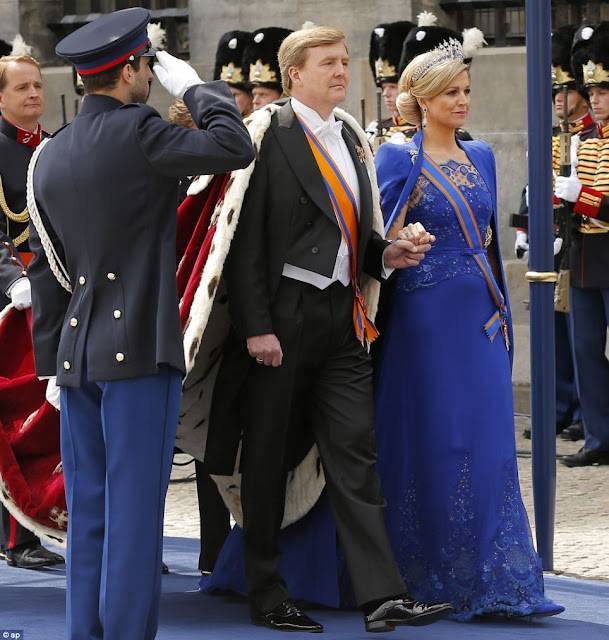 Dutch King Willem-Alexander is given three cheers by guests and his wife Queen Maxima inside the Nieuwe Kerk or New Church